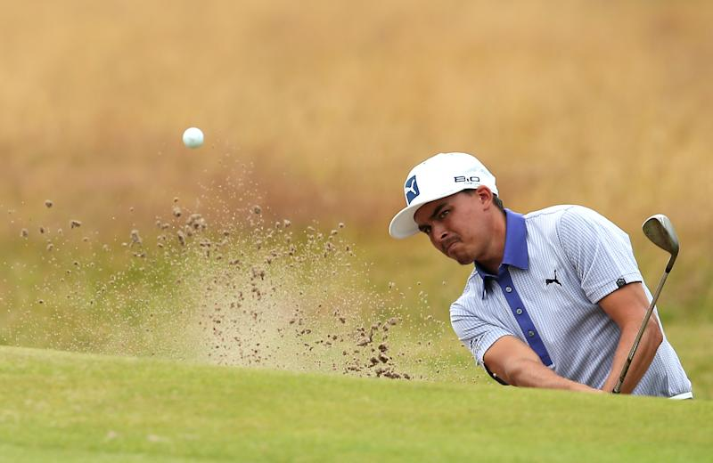 US golfer Rickie Fowler plays from a bunker on the 18th hole during his third round 68, on day three of the 2014 British Open Golf Championship at Royal Liverpool Golf Course in Hoylake, north west England on July 19, 2014