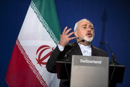 Iran's Foreign Minister Javad Zarif gestures as he speaks during a news conference at the Swiss Federal Institute of Technology in Lausanne (Ecole Polytechnique Federale De Lausanne) on April 2, 2015, after Iran nuclear program talks finished with extended sessions. REUTERS/Brendan Smialowski/Pool