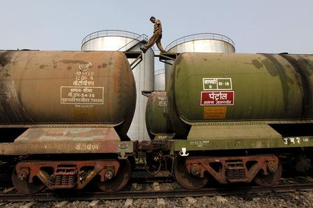 File photo of a worker walking atop a tanker wagon to check the freight level at an oil terminal on outskirts of Kolkata