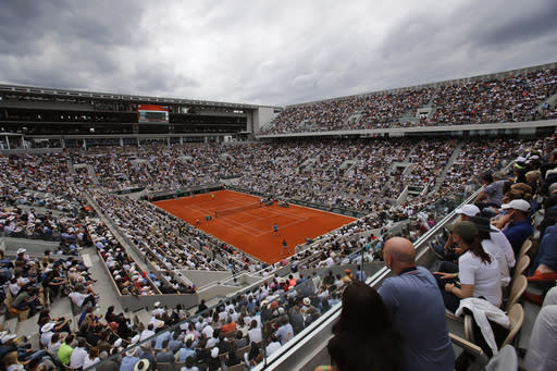FILE - In this Sunday, June 9, 2019, file photo, Austria's Dominic Thiem, near side, plays a shot against Spain's Rafael Nadal during the men's final match of the French Open tennis tournament on the center court at Roland Garros stadium in Paris. (AP Photo/Christophe Ena, File)