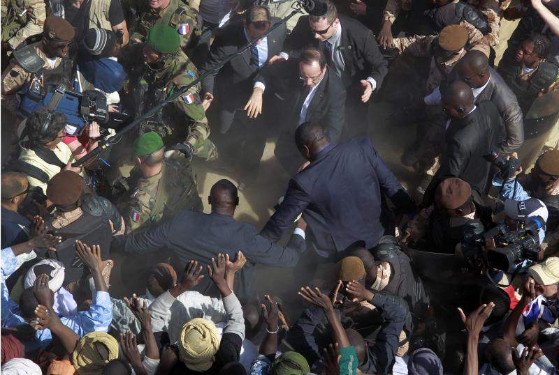 French President Francois Hollande, upper center, is surrounded by security as he greets well-wishers during his two-hour-long visit to Timbuktu, Mali, Saturday Feb. 2, 2013.(AP Photo/Jerome Delay)