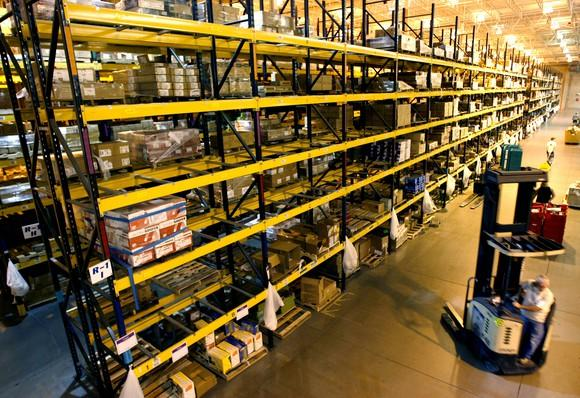Amazon warehouse showing huge racks full of different products