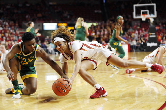 Baylor guard Moon Ursin, left, fights for the ball with Iowa State guard Jade Thurmon during the first half of an NCAA college basketball game, Sunday, March 8, 2020, in Ames, Iowa. (AP Photo/Charlie Neibergall)