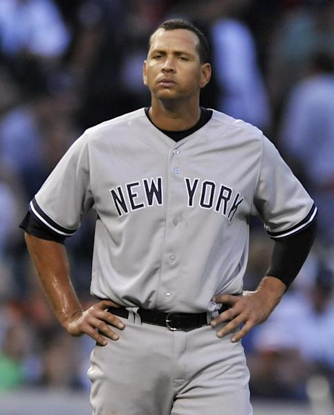 New York Yankees' Alex Rodriguez looks on during the third inning of a baseball game against the Chicago White Sox in Chicago, Monday, Aug. 5, 2013. (AP Photo/Paul Beaty)