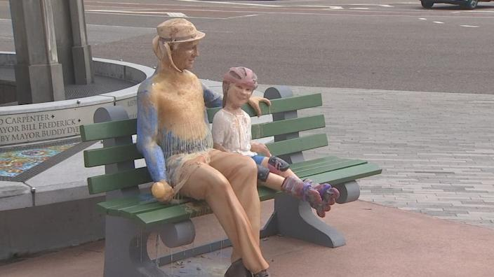 For the final sculpture of the series, the artists sculpted a chipper grandfather smiling alongside his young granddaughter.