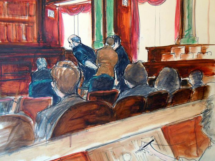 In this courtroom drawing, Osama bin Laden's son-in-law, Sulaiman Abu Ghaith, leans forward as he is handcuffed in U.S. federal court in Manhattan, after a hearing where he pleaded not guilty Friday, March 8, 2013, to plotting against Americans in his role as al-Qaida's top spokesman. The case marks a legal victory for the Obama administration, which has long sought to charge senior al-Qaida suspects in U.S. federal courts instead of holding them at the military detention center at Guantanamo Bay, Cuba. (AP Photo/Elizabeth Williams)