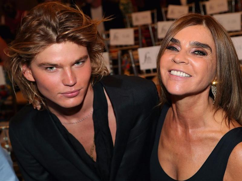 Jordan Barrett was presented with an award by Carine Roitfeld and shared a visible chemistry. Source: Getty