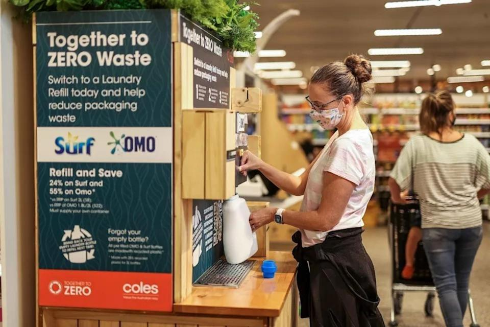 Shoppers can refill detergent and soap containers at the packageless Surf and Omo refill station. Source: Coles Group