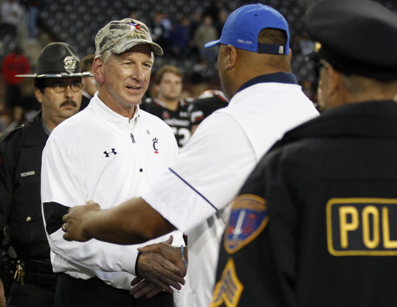 Cincinnati head coach Tommy Tuberville greets Brigham Young head coach Kalani Sitake following Cincinnati's 20-3 loss in an NCAA college football game, Saturday, Nov. 5, 2016, in Cincinnati. (AP Photo/Gary Landers)