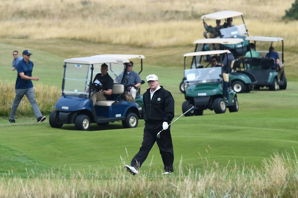 <p>The US president plays a round of golf on the Ailsa course at Trump Turnberry in July 2018</p>AFP/Getty