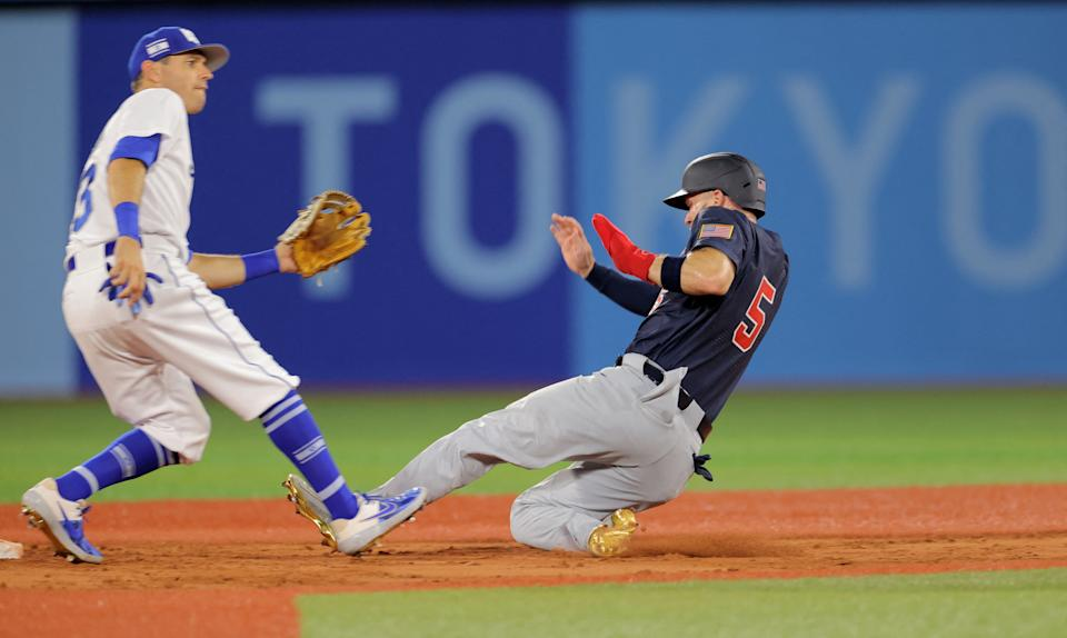 USA's Eric Filia (R) slides safely to steal the second base as Israel's second baseman Ian Kinsler (L) looks on during the eighth inning of the Tokyo 2020 Olympic Games baseball opening round group B game between USA and Israel at Yokohama Baseball Stadium in Yokohama, Japan, on July 30, 2021. (Photo by KAZUHIRO FUJIHARA / AFP) (Photo by KAZUHIRO FUJIHARA/AFP via Getty Images)