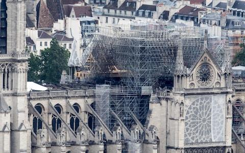 Notre-Dame lost its gothic spire in a major blaze in April - Credit: REX
