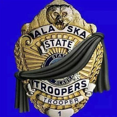An illustration showing a black band across an officer's shield appears on the official Facebook page of the Alaska State Troopers in Anchorage