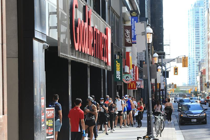 TORONTO, ON - JULY 31: Goodlife Fitness on Yonge opened today to lines of fit patrons waiting to get back in the gym. (Rene Johnston/Toronto Star via Getty Images)