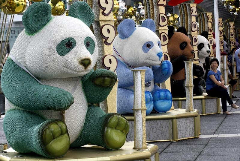 Giant pandas decorations are displayed outside a Hong Kong shopping mall Wednesday, June 13, 2007, to mark the 10th anniversary of Hong Kong handover to China. (AP Photo/Vincent Yu)