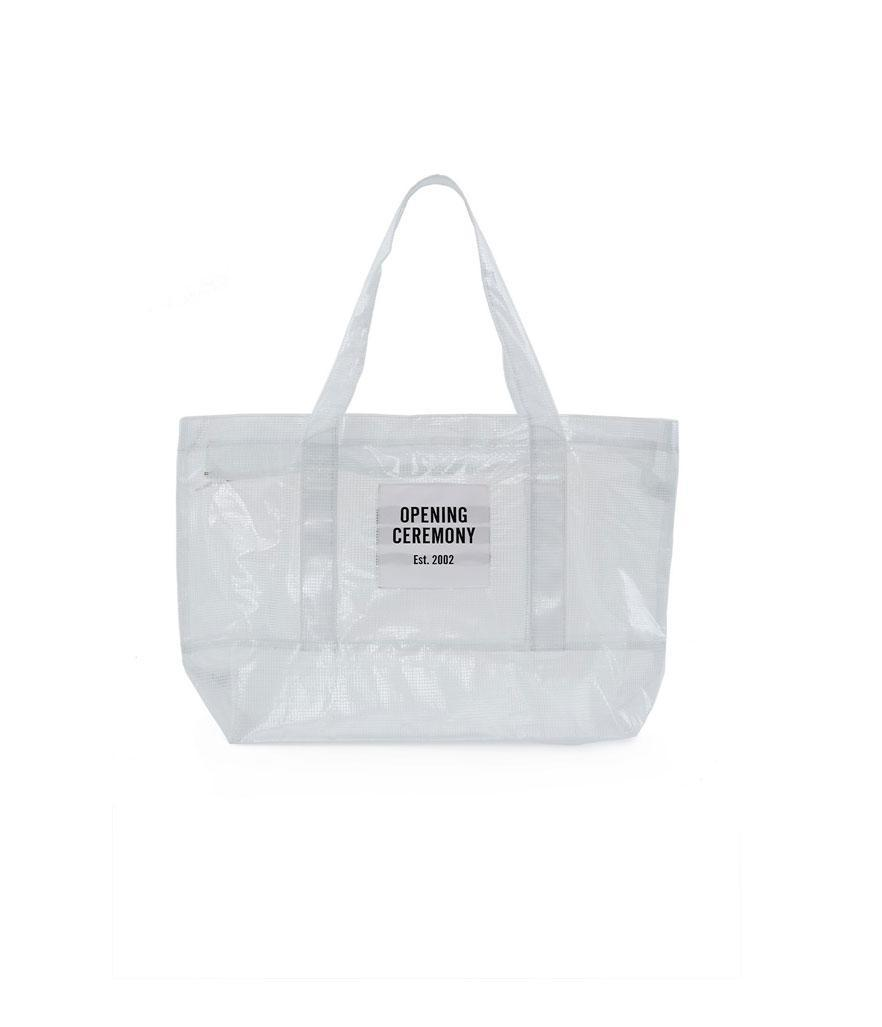 """<p><span>Mesh Tote Bag, $45,</span><a rel=""""nofollow noopener"""" href=""""https://www.openingceremony.com/mens/opening-ceremony/pvc-chntwn-tote-mdm-ST205279.html?gender=w"""" target=""""_blank"""" data-ylk=""""slk:openingceremony.com"""" class=""""link rapid-noclick-resp""""> <span>openingceremony.com</span></a> </p>"""