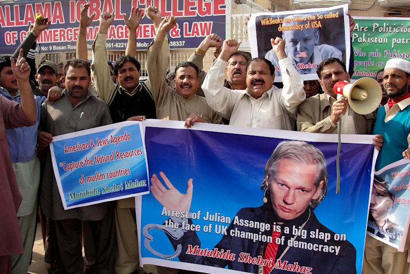 Pakistani protesters rally to condemn the arrest in London of WikiLeaks founder Julian Assange, seen in poster,  during a protest in Multan, Pakistan, on Thursday, Dec. 9, 2010.  (AP Photo/Khalid Tanveer)