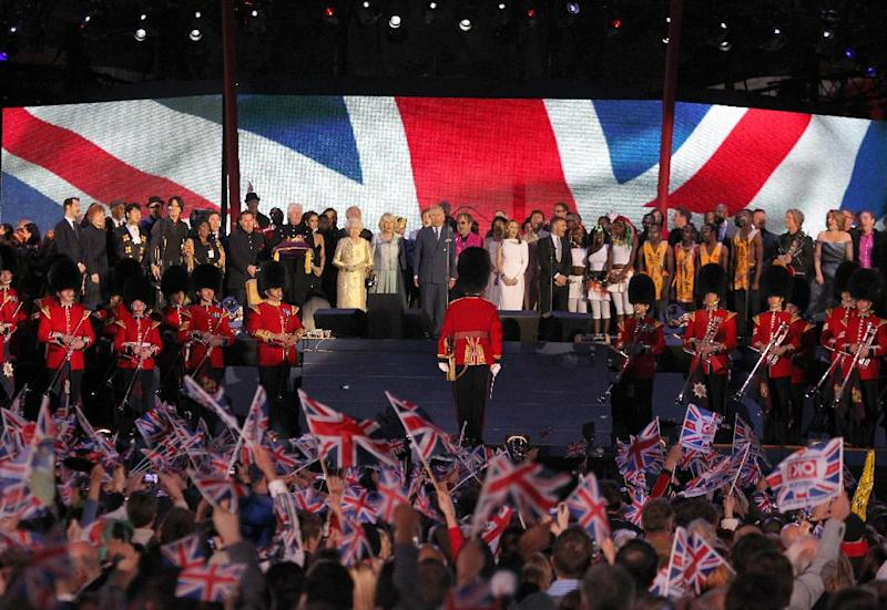 Britain's Prince Charles, centre, Camilla, Duchess of Cornwall, and Britain's Queen Elizabeth II, centre left, are joined on stage by performers at the conclusion of the Queen's Jubilee Concert in front of Buckingham Palace, London, Monday, June 4, 2012. The concert is a part of four days of celebrations to mark the 60 year reign of Britain's Queen Elizabeth II. (AP Photo/Joel Ryan)