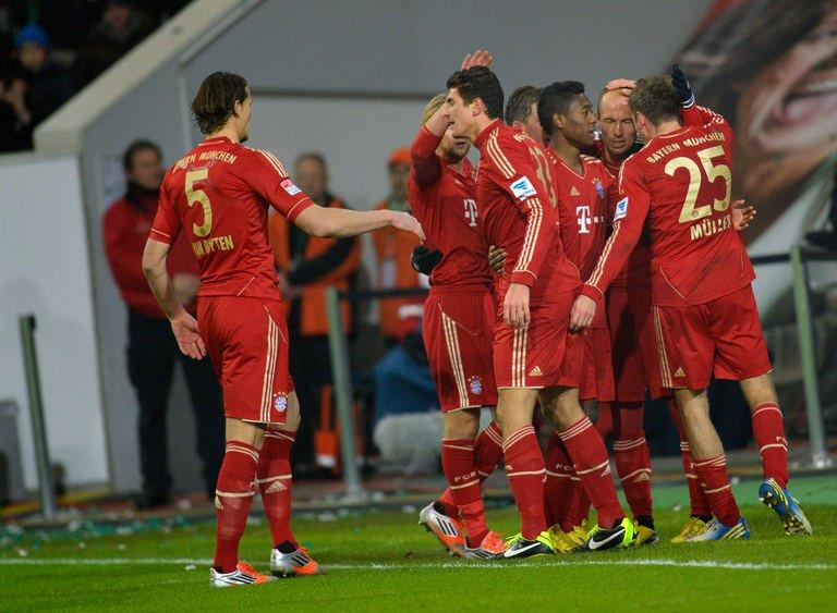 Bayern Munich's Dutch midfielder Arjen Robben celebrates scoring with his teammates during the German first division Bundesliga football match against Wolfsburg on February 15, 2013. Robben has admitted he is unhappy with his place on the bench as Bayern prepare for Tuesday's trip to Arsenal by extending their Bundesliga unbeaten run to 18 matches with victory at Wolfsburg