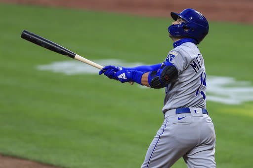 Kansas City Royals' Whit Merrifield (15) hits a sacrifice fly in the fourth inning during a baseball game against the Cincinnati Reds in Cincinnati, Wednesday, Aug. 12, 2020. (AP Photo/Aaron Doster)