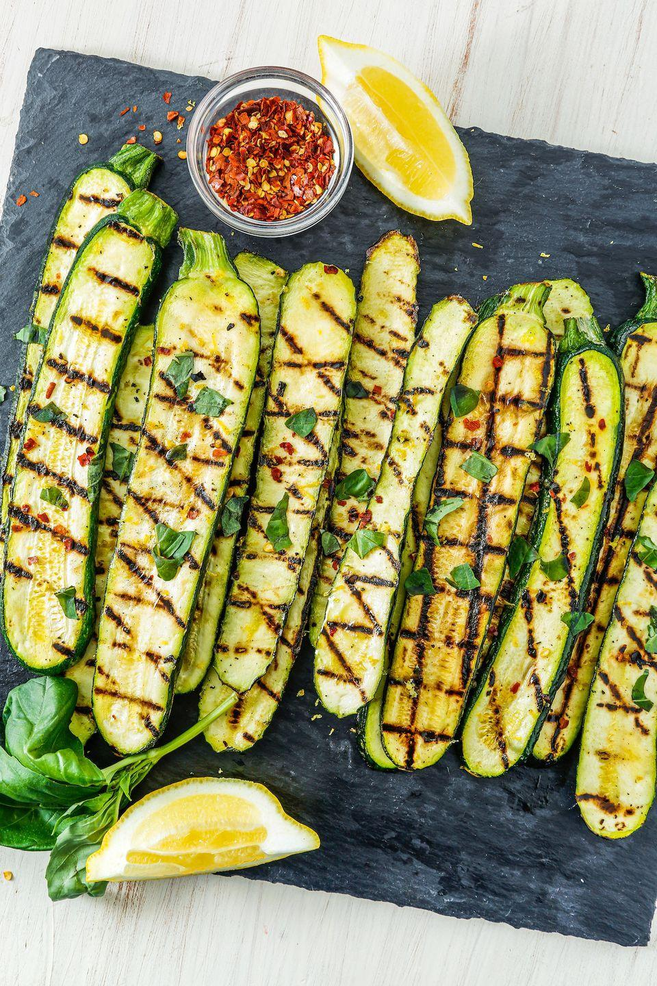 """<p>So simple, easy, and beautiful, it's hard to find a better use for fresh zucchini.</p><p>Get the recipe from <a href=""""https://www.delish.com/cooking/recipe-ideas/recipes/a53484/grilled-zucchini-recipe/"""" rel=""""nofollow noopener"""" target=""""_blank"""" data-ylk=""""slk:Delish"""" class=""""link rapid-noclick-resp"""">Delish</a>.</p>"""