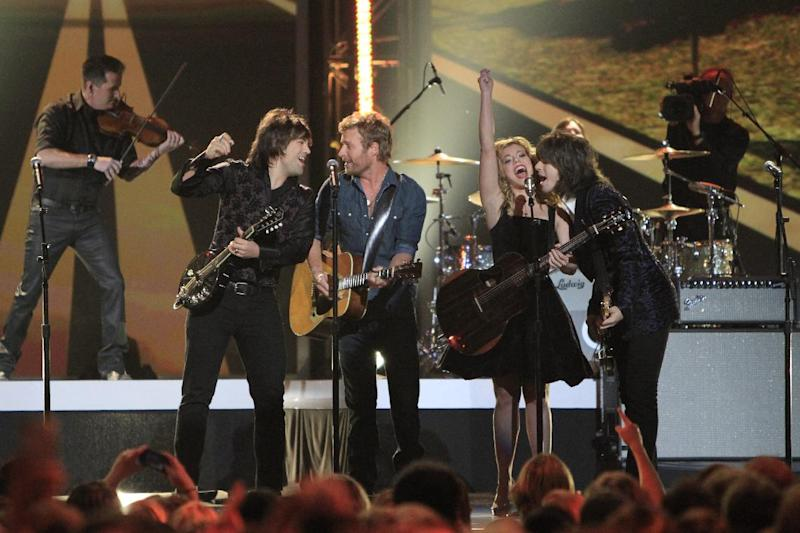 Dierks Bentley, second from left, and from left, Neil Perry, Kimberly Perry and Reid Perry, of the musical group The Band Perry, perform at the Grammy Nominations Concert Live! at Bridgestone Arena on Wednesday, Dec. 5, 2012, in Nashville, Tenn. (Photo by Wade Payne/Invision/AP)