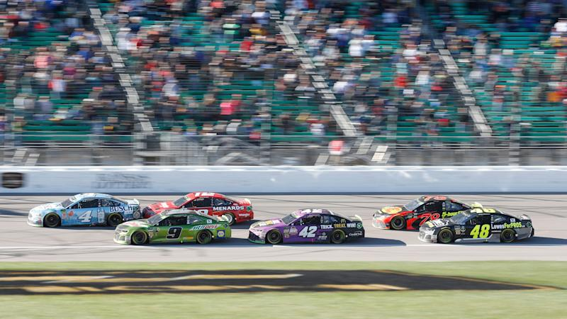 Kevin Harvick (4) leads with Chase Elliott (9) in second place at the start of the third stage during a NASCAR Cup Series auto race at Kansas Speedway in Kansas City, Kan., Sunday, Oct 21, 2018. Elliott won the race. (AP Photo/Colin E. Braley)