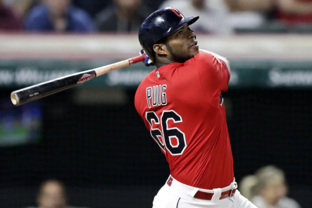 FILE - In this Sept. 18, 2019, file photo, Cleveland Indians' Yasiel Puig watches his ball after hitting the game-winning RBI-single in the 10th inning in a baseball game against the Detroit Tigers in Cleveland. The free agent outfielder and the Atlanta Braves have agreed to a one-year deal, a person with knowledge of the deal said Tuesday, July 14, 2020. (AP Photo/Tony Dejak, File)