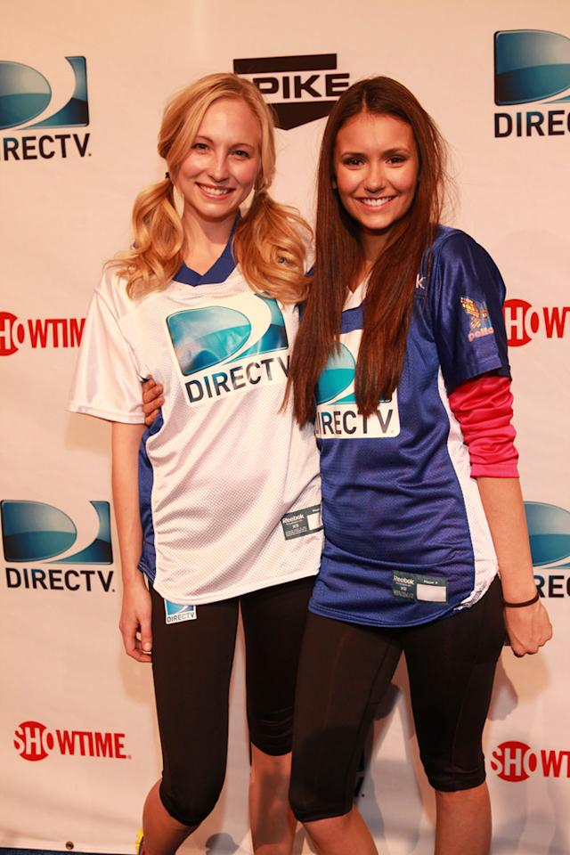 """The Vampire Diaries"" co-stars Candice Accola and Nina Dobrev arrive at the DirecTV Celebrity Beach Bowl in Indianapolis."
