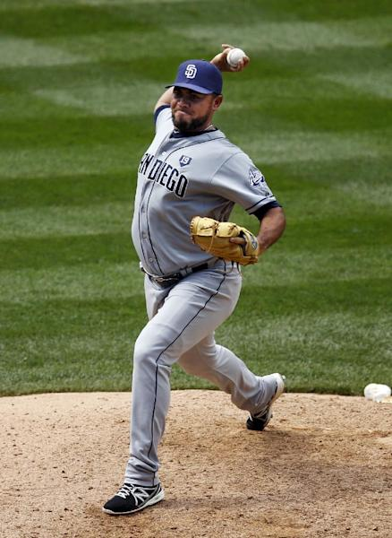 San Diego Padres relief pitcher Joaquin Benoit throws to the plate against the Colorado Rockies during the eighth inning of a baseball game on Wednesday, July 9, 2014, in Denver. (AP Photo/Jack Dempsey)