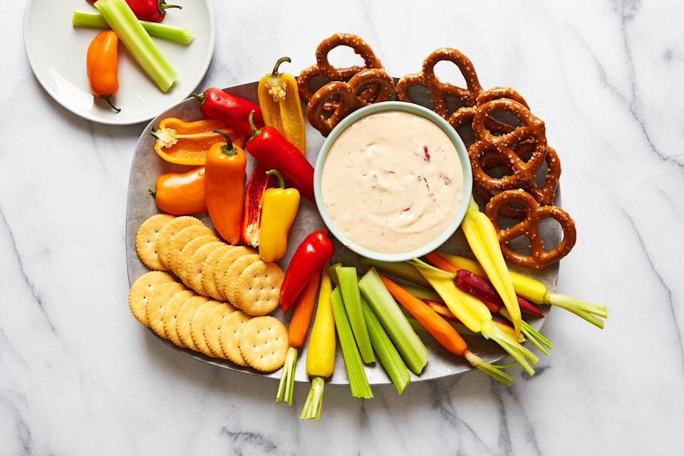 "This velvety-smooth hot take on pimento cheese spread has a hint of smokiness thanks to chipotle in adobo. Dip in pretzels, crackers, or cut up vegetables. Feel free to amp up the cheese with more chipotle or some hot sauce if you like. <a href=""https://www.epicurious.com/recipes/food/views/hot-pimento-cheese-dip-polina-chesnakova?mbid=synd_yahoo_rss"" rel=""nofollow noopener"" target=""_blank"" data-ylk=""slk:See recipe."" class=""link rapid-noclick-resp"">See recipe.</a>"
