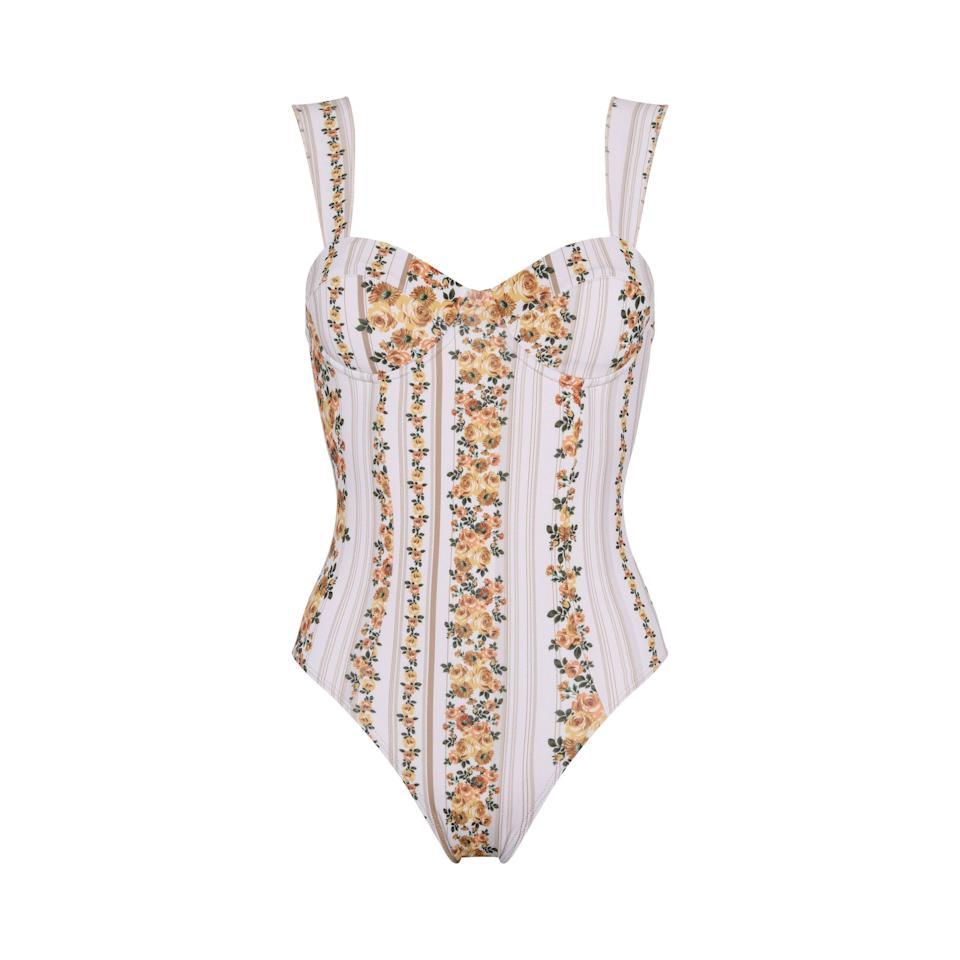 """<p><strong>Capittana </strong></p><p><strong>$179.00</strong></p><p><a href=""""https://shop.capittana.com/onepiece/mercedes-stripped-flowers"""" rel=""""nofollow noopener"""" target=""""_blank"""" data-ylk=""""slk:Shop Now"""" class=""""link rapid-noclick-resp"""">Shop Now</a></p><p>Help her knot a pareu around her waist while she relaxes poolside in this swimsuit. </p>"""