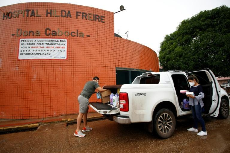 Volunteers deliver donations to the Hilda Freire Public Hospital in Iranduba, Amazonas state, Brazil, on January 20, 2021