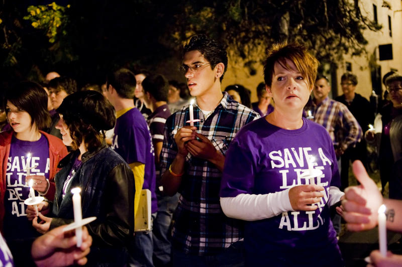 FILE - In this Oct. 20, 2010 file photo, young people participate in an anti-gay bullying candlelight vigil to commemorate the recent deaths of gay teens at The Center Project in Columbia, Mo. A new Pediatrics study found scientific evidence that it does get better for gay teens, when it comes to bullying, although young gay men fare worse than their lesbian peers. (AP Photo/The Columbia Daily Tribune, Joshua A. Bickel, File)