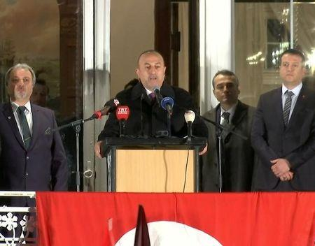 A still image taken from video footage shows Turkish Foreign Minister Mevlut Cavusoglu addressing rally in Hamburg