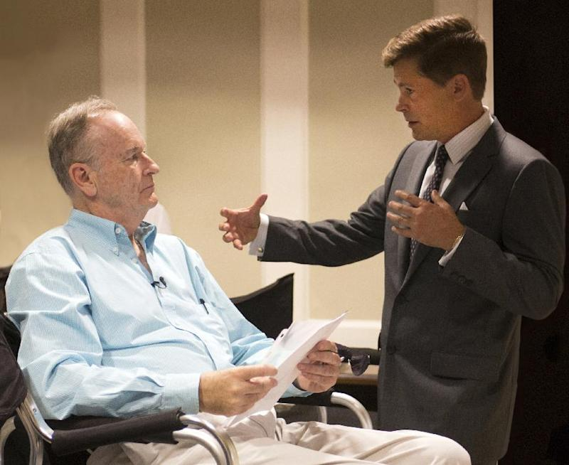 """This June 15, 2013 photo released by National Geographic Channel shows Fox News commentator and author Bill O'Reilly, left, and actor Rob Lowe on the set of National Geographic Channel's """"Killing Kennedy,"""" in Richmond, Va. O'Reilly, whose book """"Killing Jesus: A History"""" is being published Sept. 24, has already inked a deal with National Geographic Channel for the movie version. And he's got three similar books in the works. While he declined to divulge the topics, the upcoming projects will make """"very, very dramatic history come alive on the page and then in the movies,"""" O'Reilly said in an interview on the set of """"Killing Kennedy,"""" the film adaptation of his book about President John F. Kennedy's 1963 assassination. (AP Photo/ National Geographic Channel, Kent Eanes)"""
