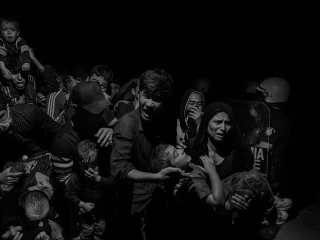 <p>Refugees and migrants arriving on Lesbos, Greece in 2015, are transferred to the Moria refugee camp where they register with authorities before being able to move on. (© Alex Majoli/Magnum Photos) </p>
