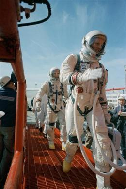 Commander Neil Armstrong (R) and pilot David R. Scott prepare to board the Gemini-Titan VIII in this March 16, 1966 NASA handout photo. The mission conducted the first docking of two spacecraft in orbit and landed safely back on Earth after an emergency abort.