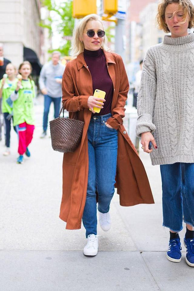 <p><em>Game of Thrones</em> star Emilia Clarke keeps it cool and casual carrying a woven basket bag with an orange trench coat and jeans in New York City. (Photo: Gotham/GC Images) </p>