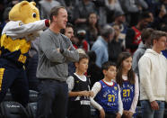 Retired NFL quarterback Peyton Manning looks on as the Denver Nuggets host the Toronto Raptors in the first half of an NBA basketball game Sunday, March 1, 2020. (AP Photo/David Zalubowski)