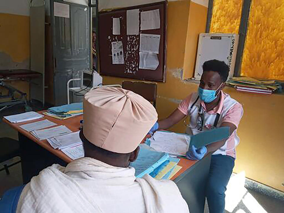 "In this Thursday Dec.31, 2020, photo provided by Medecins Sans Frontieres, a Medecins Sans Frontieres staff member speks to a patient in Adigrat, in Tigray, northern Ethiopia. From ""emaciated"" refugees to crops burned on the brink of harvest, starvation threatens the survivors of more than two months of fighting in Ethiopia's Tigray region. Authorities say more than 4.5 million people, or nearly the entire population, need emergency food. The first humanitarian workers to arrive after weeks of pleading with Ethiopia for access describe weakened children dying from diarrhea after drinking from rivers, and shops that were looted or depleted weeks ago. (Medecins Sans Frontieres via AP)"