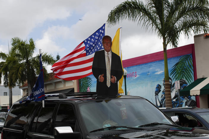 Supporters of President Donald Trump drive in caravan down Calle Ocho in the Little Havana neighborhood of Miami, Saturday, Oct. 31, 2020. (AP Photo/Rebecca Blackwell)
