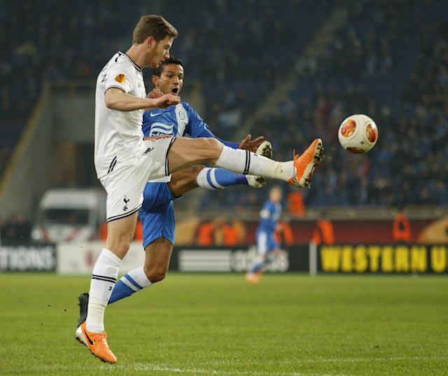 Tottenham's Jan Vertonghen, left, challenges for the ball against Matheus of Ukrainian Dnipro, during their UEFA Europa League round of 32, first leg soccer match at GSP Stadium in Dnipropetrovsk, Ukraine,Thursday, Feb. 20, 2014. (AP Photo/Sergei Kozin)