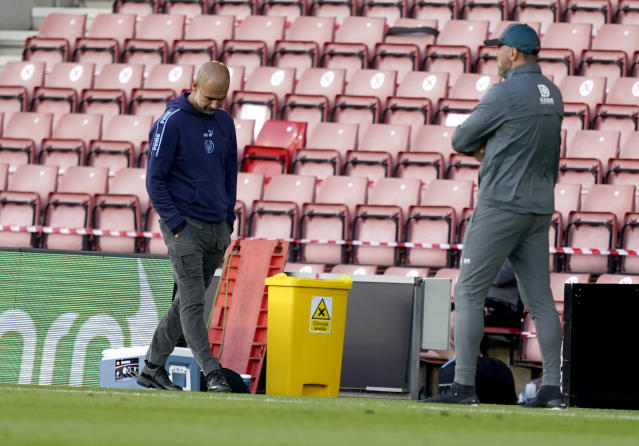 Manchester City's head coach Pep Guardiola, left, reacts as Southampton's manager Ralph Hasenhuettl watches during the English Premier League soccer match between Southampton and Manchester City at St. Mary's Stadium in Southampton, England, Sunday, July 5, 2020. (AP Photo/Will Oliver,Pool)