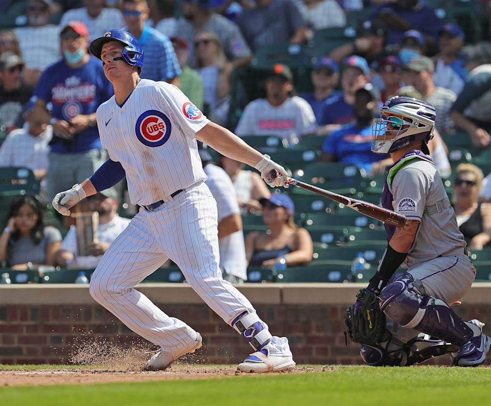 CHICAGO, ILLINOIS - AUGUST 25: Frank Schwindel #18 of the Chicago Cubs hits a triple against the Colorado Rockies at Wrigley Field on August 25, 2021 in Chicago, Illinois. The Cubs defeated the Rockies 5-2. (Photo by Jonathan Daniel/Getty Images)
