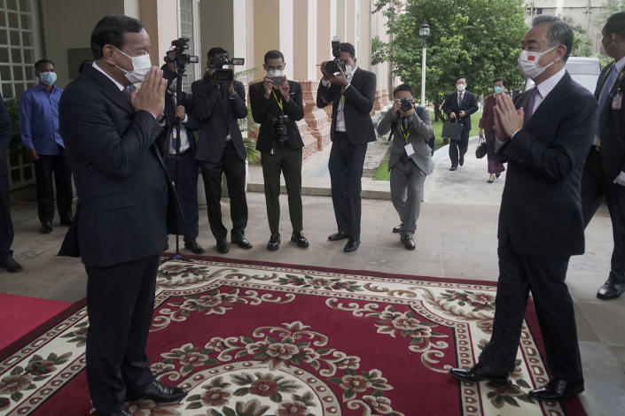 Chinese Foreign Minister Wang Yi, foreground right, greets with his Cambodian counterpart Prak Sokhonn, foreground left, in Phnom Penh, Cambodia, Sunday, Sept. 12, 2021. Wang is visiting Cambodia, where's he expected to meet with Prime Minister Hun Sen and other officials to discuss COVID-19 and other regional issues. (Kith Serey/Photo Photo via AP)