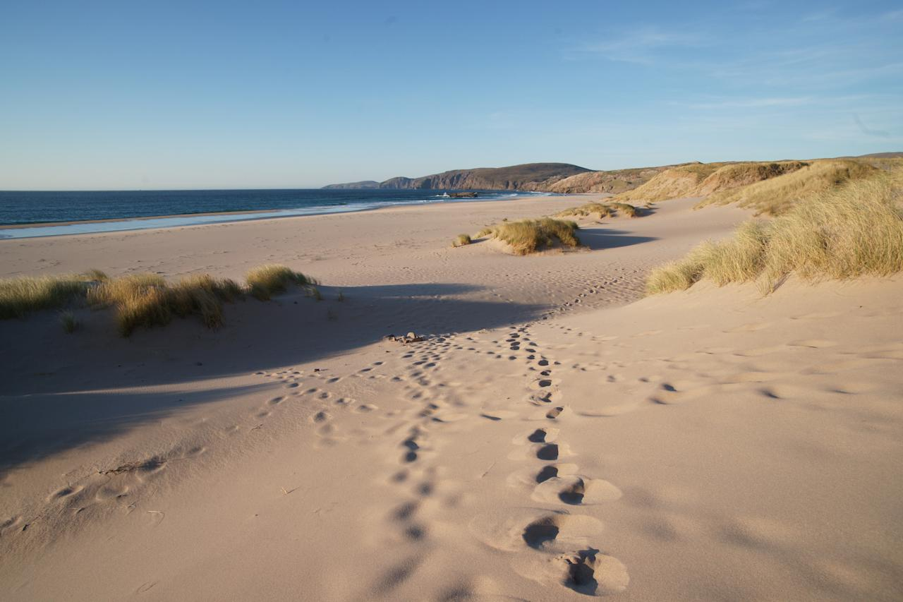 This remote natural bay in Sutherland is considered one of Scotland's most beautiful beaches, thanks to its unspoiled terrain and the surrounding grassy dunes that give it its romantic appearance. [Photo: Getty]