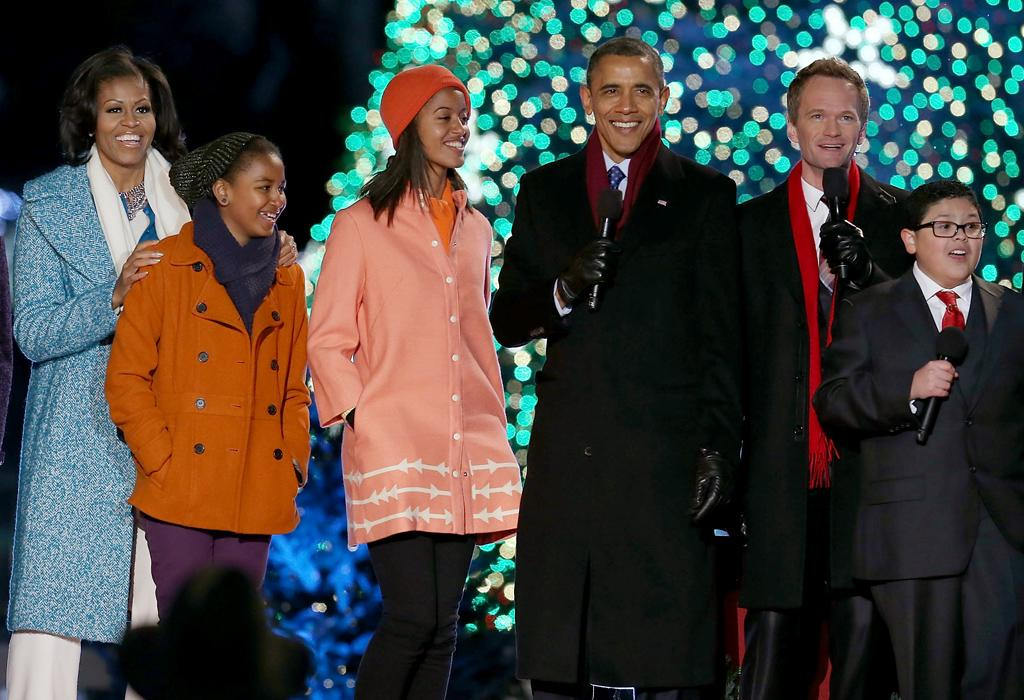 WASHINGTON, DC - DECEMBER 06:  U.S. President Barack Obama, sings a Christmas song with his daughters Malia (3rd-L) and Sasha (2nd-L), first lady Michelle Obama (L), Actor Neil Patrick Harris (2nd-R), and Rico Rodriguez (R),during the annual lighting of the National Christmas tree on December 6, 2012 in Washington, DC. This year is the 90th annual National Christmas Tree Lighting Ceremony.  (Photo by Mark Wilson/Getty Images)