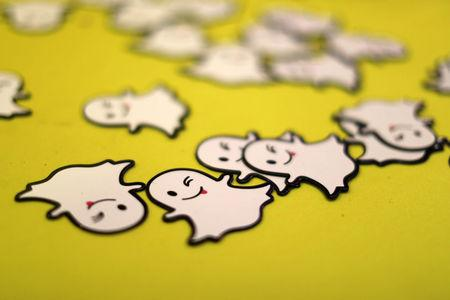 FILE PHOTO: The logo of messaging app Snapchat is seen at a booth at TechFair LA, a technology job fair, in Los Angeles, California, U.S., January 26, 2017. To match Analysis SNAP-IPO/HARDWARE      REUTERS/Lucy Nicholson/File Photo