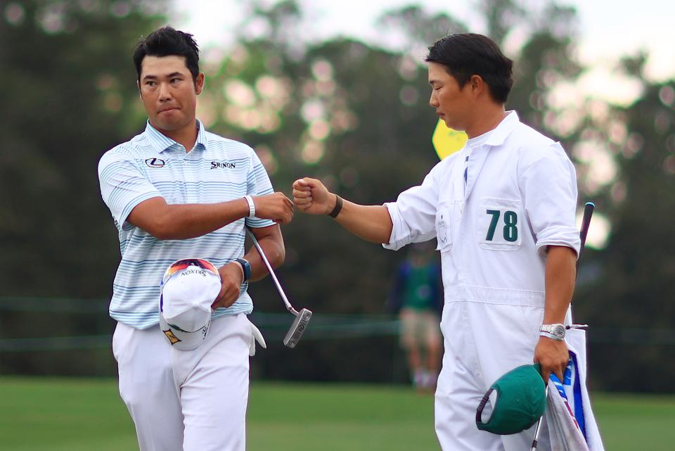 AUGUSTA, GEORGIA - APRIL 10: Hideki Matsuyama of Japan celebrates with his caddie Shota Hayafuji after finishing on the 18th green during the third round of the Masters at Augusta National Golf Club on April 10, 2021 in Augusta, Georgia. (Photo by Mike Ehrmann/Getty Images)